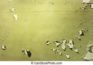 Wall with peeled off green paint