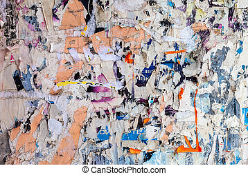 Wall with scraps of old paper as background