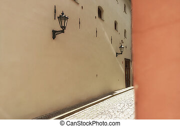 Wall with street lamp in the old town of Riga