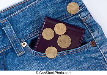 Wallet and fractional coin are lying in side pocket of blue jeans.