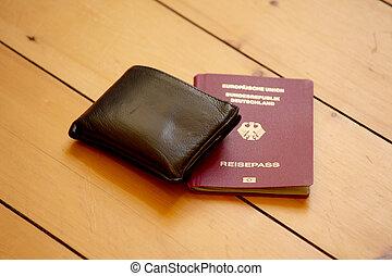 wallet and german passport on wodden floor