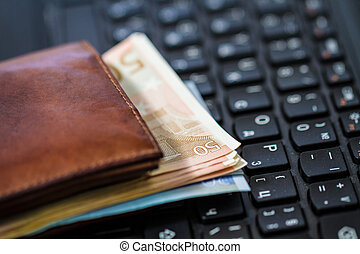 Wallet and  money on keyboard