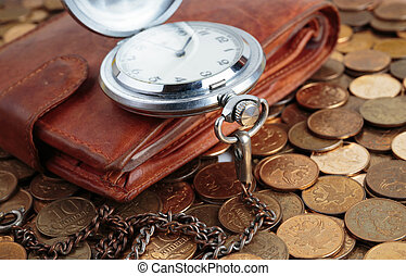 Wallet and pocket watch on the coins background