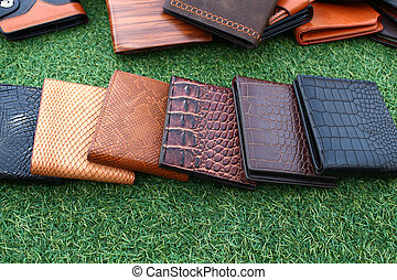 wallet of leather skin on grass