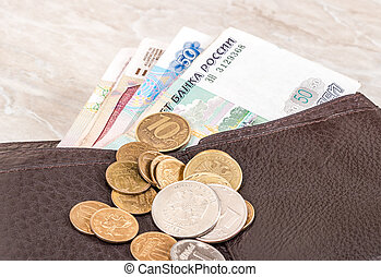 Wallet open with russian rubles banknotes and coins sticking out