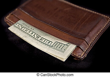 wallet with a hundred dollar bill