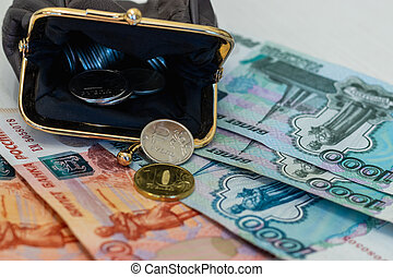 wallet with coins and banknotes on the table surface