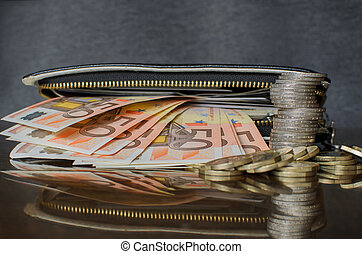 Wallet With Coins And Banknotes