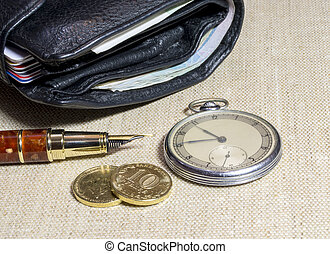 Wallet with money and vintage watch