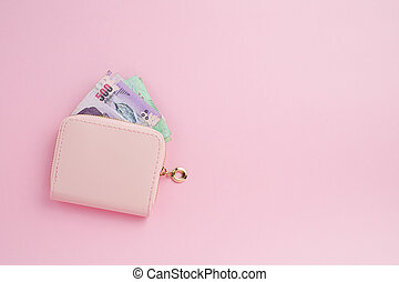 Wallet with Thai currency banknote on pink background for business, finance, investment and saving money concept