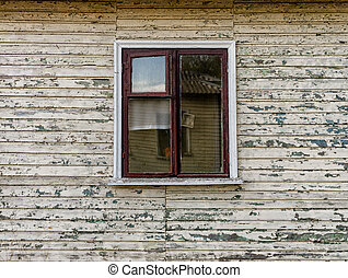 walls and window of an old abandoned village wooden house in Ukraine after the war