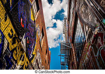 Walls of old buildings in Graffiti Alley, Baltimore, Maryland.