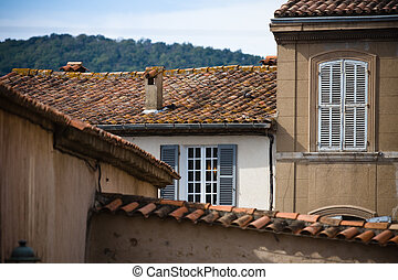 Walls of old houses with windows