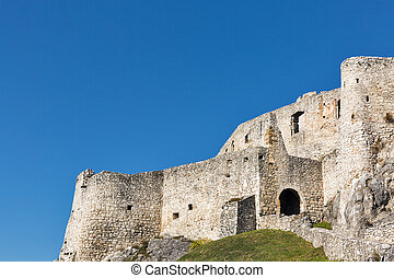 Walls of Spis Castle against clear blue sky in Slovakia....