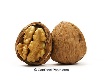 walnut and a cracked walnut on white background