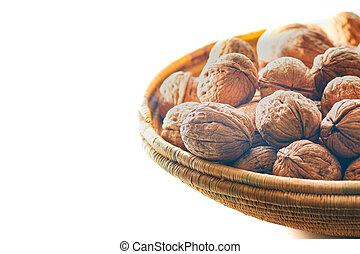 Walnut basket near the window creating white background