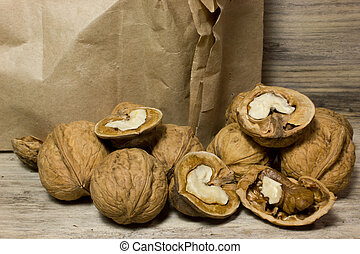 Walnut in shell on wooden background