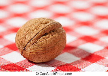 walnut on picnic tablecloth