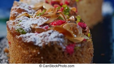 Walnut shavings on cake close up, macro. Delicious dessert...