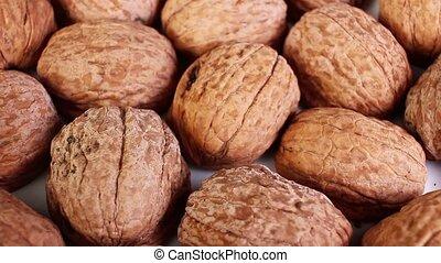Walnut shell walnuts shells rotating texture pattern closeup footage
