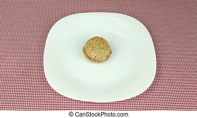 Walnut sweets - Woman puts walnut sweets on white dish