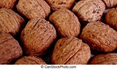Walnut texture. Brown big whole walnuts as background....