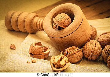 Walnut with nutcracker on rustic table - Healthy food full ...
