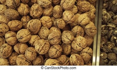 Walnuts and dried mushrooms sold in supermarket stock...