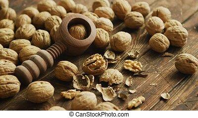 Walnuts and nutcracker on table - Closeup shot of fresh...