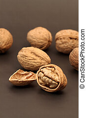 Cracked walnut with nutshell on background with walnuts