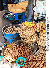 Walnuts for sale at a market stall