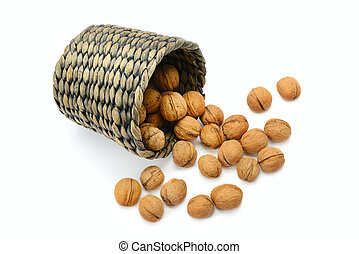 walnuts in a basket isolated on white background