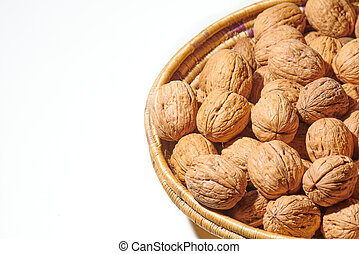 Walnuts in a basket on a white background
