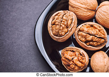 Walnuts in a black plate