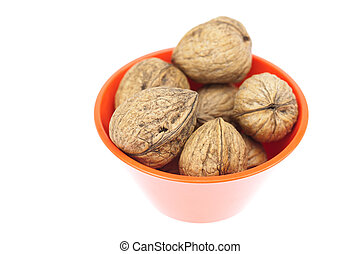 walnuts in a bowl isolated on white