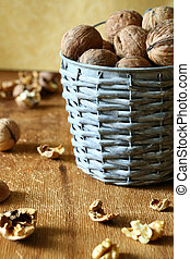 walnuts in a bucket and shells