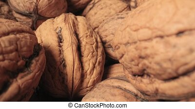 Pile of walnuts macro slider shot with probe lens in between