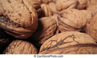 Pile of walnuts macro slider shot with probe lens