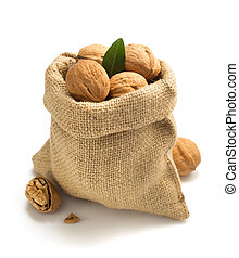 walnuts in bag on white background