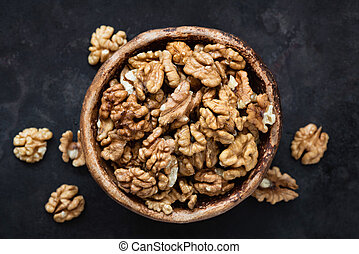 Walnuts in bowl top view