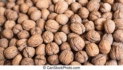 Pile of walnuts (Juglans regia) in shell.