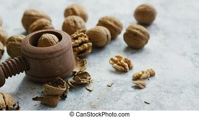 Walnuts in shells and cracker - Composition of wooden...