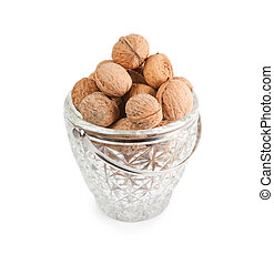 Walnuts in the crystal vase isolated on white background