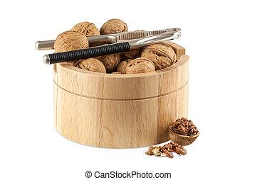 Walnuts in utensil with nutcracker