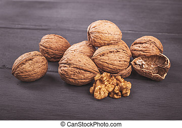 Walnuts isolated on a wooden table