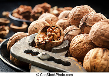 Walnuts. Nuts of walnuts. Nippers for cutting nuts