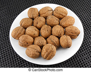 Walnuts on a white plate