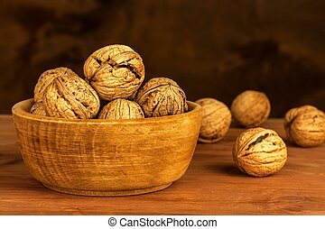 Walnuts on a wooden table. Healthy food. Sale of nuts. Advertising for walnuts.