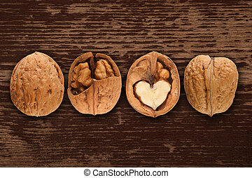 walnuts on brown wooden background