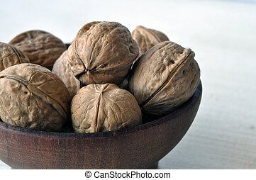 Some walnuts in a bowl